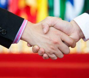 Handshake on red background