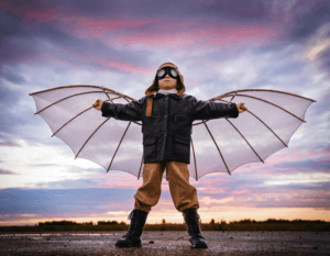 Boy dressed as pilot with wings